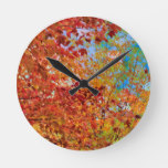 Beautiful Autumn Leaves Against Blue Sky Round Clock
