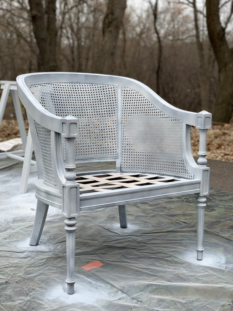 Cane chair being painted