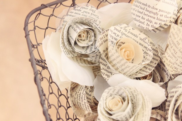 Handmade vintage paper rosettes for the tables and flower girls