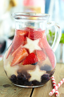 Red, white and blue lemonade with strawberry, blueberry and pear