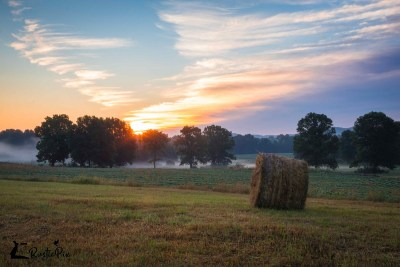Hay Bales on the field sunrise