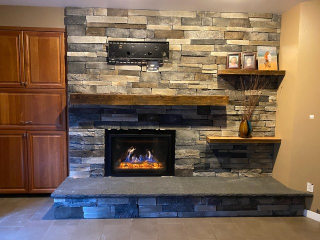Custom Fireplace using stone & reclaimed timbersdesigned for