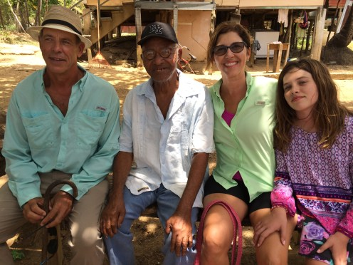 Brenda, Anna and David seated with Mr. Rolin Rich – the oldest living resident on St. Helene