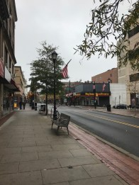 Stores and restaurants form an upbeat atmosphere down George Street