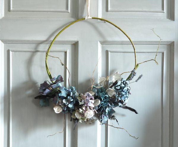 Simple wicker wreath with blue hydrangeas, honesty, lavender, contorted willow