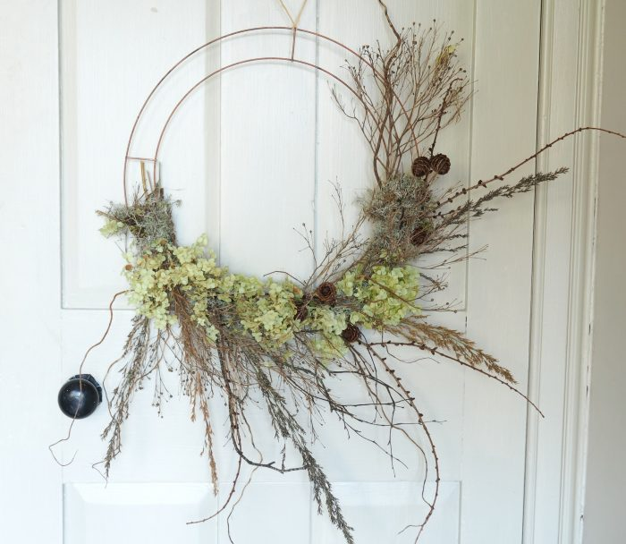 Large wire wreath with dried crambe, cones and green hydrangea