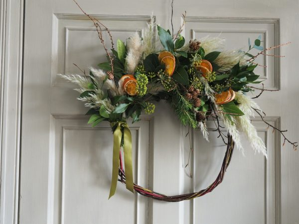 Festive wreath with oranges and pampas grass