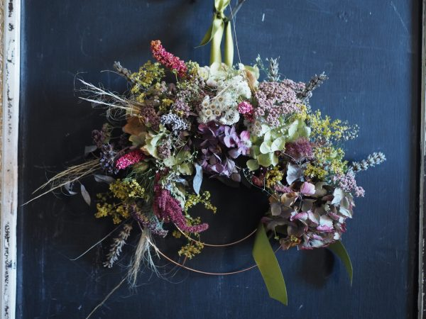 Small copper ring with dried flowers in soft greens and pinks