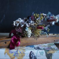 Vintage wooden shuttle with dried flowers