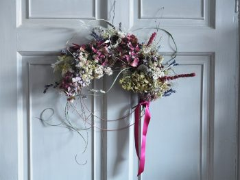 Wreath with dried maroon and white flowers