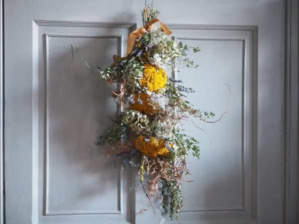 Colourful dried flower swag with achillea and lunaria