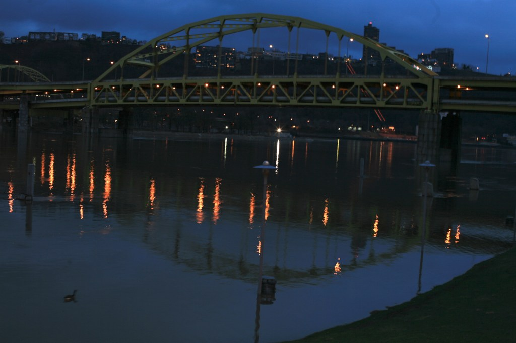 Just after dusk the Allegheny River flooding at West End Bridge