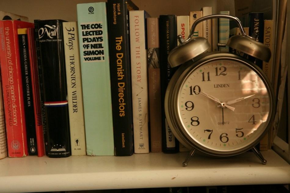 bookshelf and alarm clock
