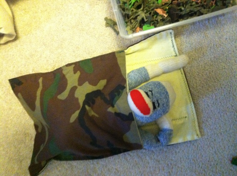 Sock Monkey in Camo Sleeping Bag