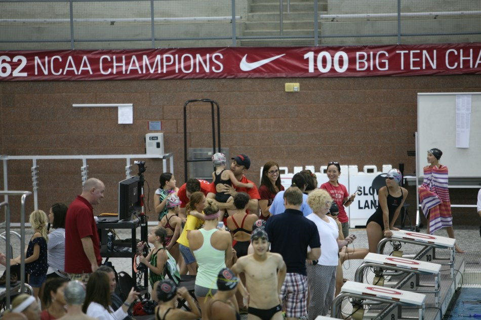Maura completes 100 M freestyle
