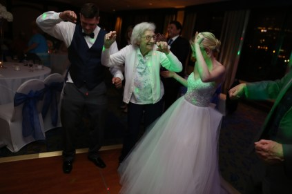 grandma dancing with bride and groom