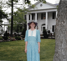 Ruth in front of mansion