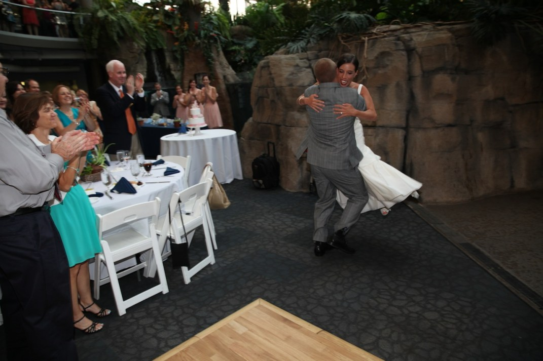 Twirling his bride in the air