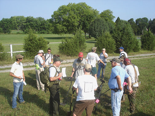 About 25 volunteers from MTSU's anthropology program and Middle Tennessee Metal Detectors gather July 12 at the Stones River Battlefield to begin searching for Civil War artifacts near the Harding house site.