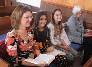 Enjoying the singing during Sunday services at Mt. Carmel Baptist Church are, from left, Crystal Harris; her daughter Mikayla Harris, 9; her niece Annabelle Marlin, 11; and the church's secretary-treasurer, Brenda Marlin. JOHN BUTWELL/The Murfreesboro Post