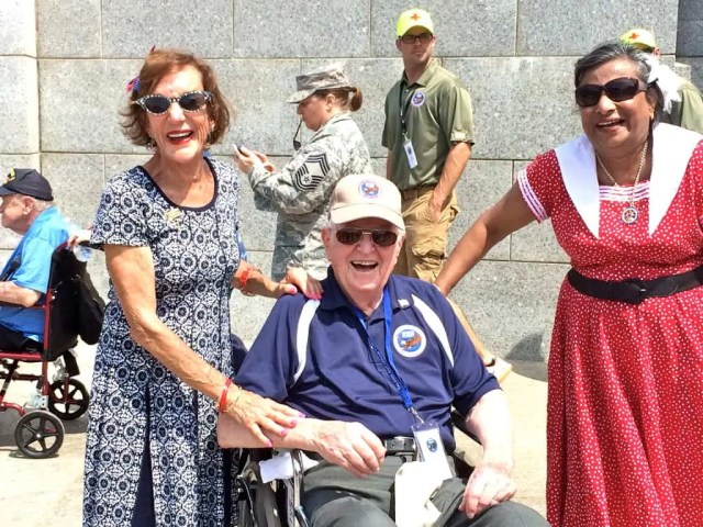 1940s music playing and two gals who treated the veterans to a kiss and a thank you!