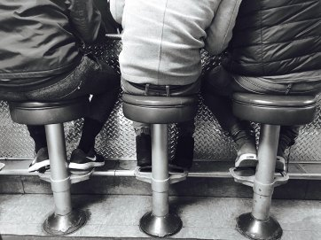 Threee butts on stools