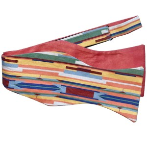 untied Multi color stripe bow tie with pink on reverse side