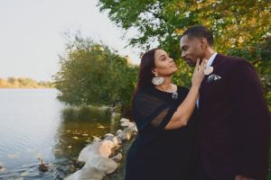 happy couple. man wearing bow tie with black botanical print and cream lapel flower