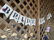 """""""Bride to be"""" banner, hand painted by one of my talented sisters in law!"""