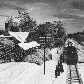 Commuters gather on snowy morning in 1956 at the Ruxton station. It was razed in October 1963 and replaced with Ruxton Township apartments. Photo: Maryland Historical Society