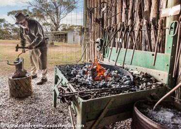 Old Jim the blacksmith still hard at it.