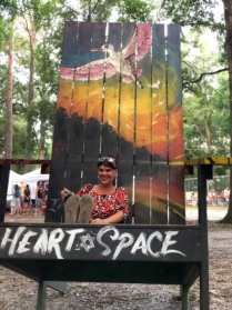 sitting on a giant adirondock chair at spirit of the suwannee music park in Florida along our road trip