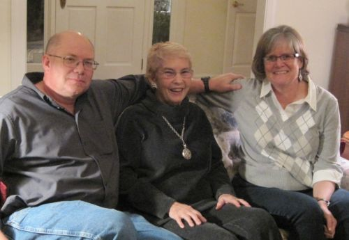 Paul with wife Daryl and Sally Rhine Feather (center)