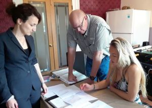 Paul giving remote viewing guidance to a student with interpreter Natasha Kharikova (L) standing by to assist