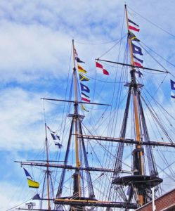 "Naval signal flags have long been used to ""stand for"" words or phrases useful in coordinating naval maneuvers. Here the museum ship HMS Victory spells out the message, ""England expects that every man will do his duty"" made famous during the battle of Trafalgar"