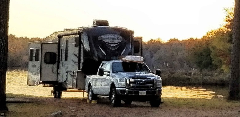 Awesome campsite in the Tombigbee National Forest right on Davis Lake with the sun setting behind my rig.
