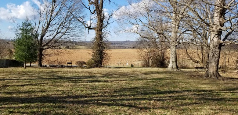 The front porch view of Thomas Woodson's farm and the railroad bridge in the distance.