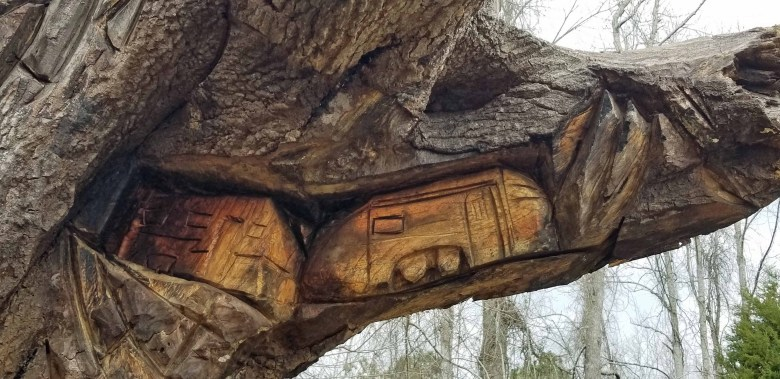 A unique chainsaw carving of travel trailers at YellowHammer RV park.