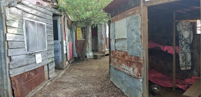 The Global Village and Discovery Center in Americus, Georgia starts with a walk through poverty housing in the form of a settlement.