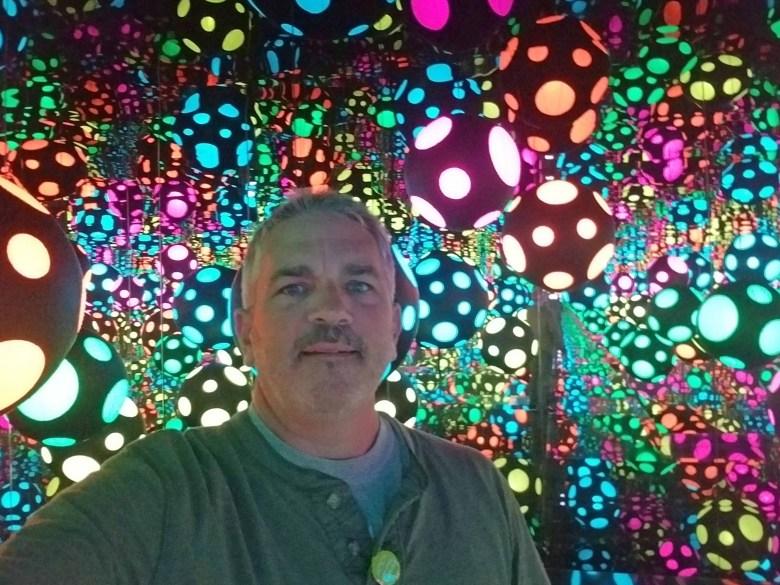 Brad Saum in the  the Kusama Infinity Mirrored Room.