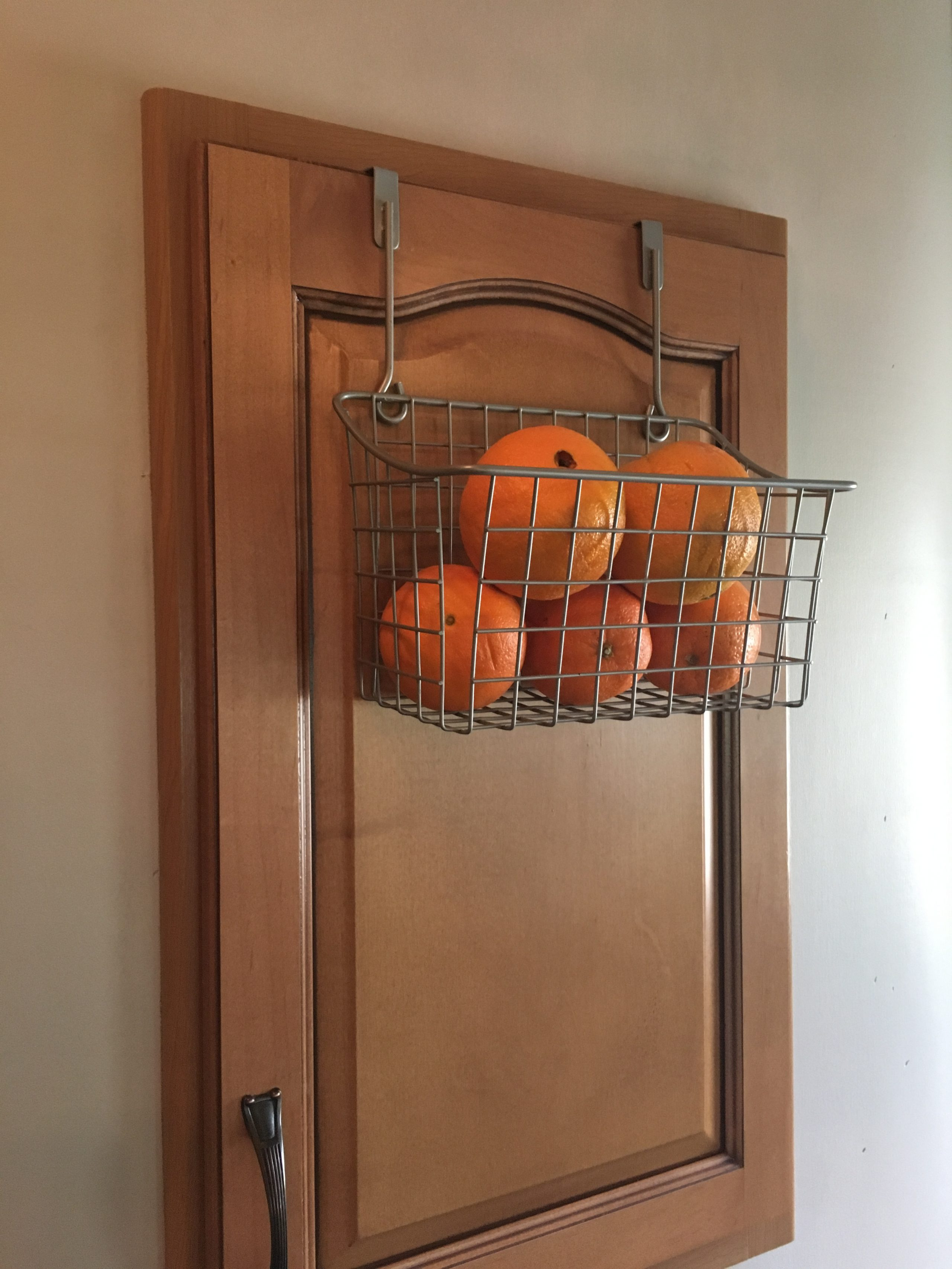 baskets hung with mug hooks for fruit / root vegetable storage | RVinspiration.com | Ideas for campers, motorhomes, and travel trailers