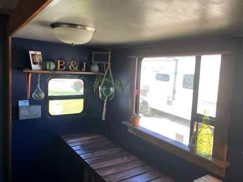 Travel trailer RV with wood framed windows