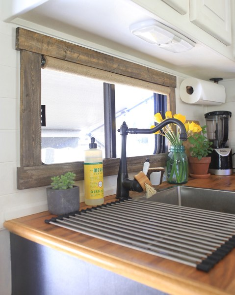 Motorhome RV window framed with real wood by ModernMountainLife.com