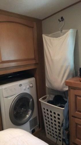 #RV washer dryer combo and #laundry hamper | RVinspiration.com | idea for a #camper, #traveltrailer, or #motorhome