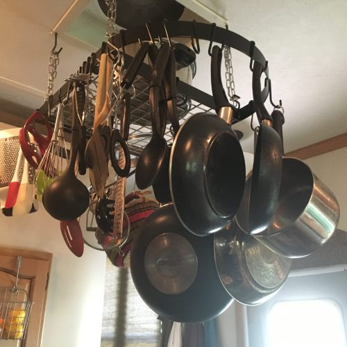 Pot rack in RV kitchen | RVinspiration.com - storage and organization ideas for campers and motorhomes
