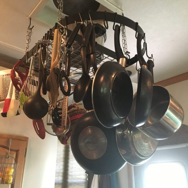 A pot rack adds #storage to our #RV #kitchen | RVinspiration.com - ideas for campers and motorhomes