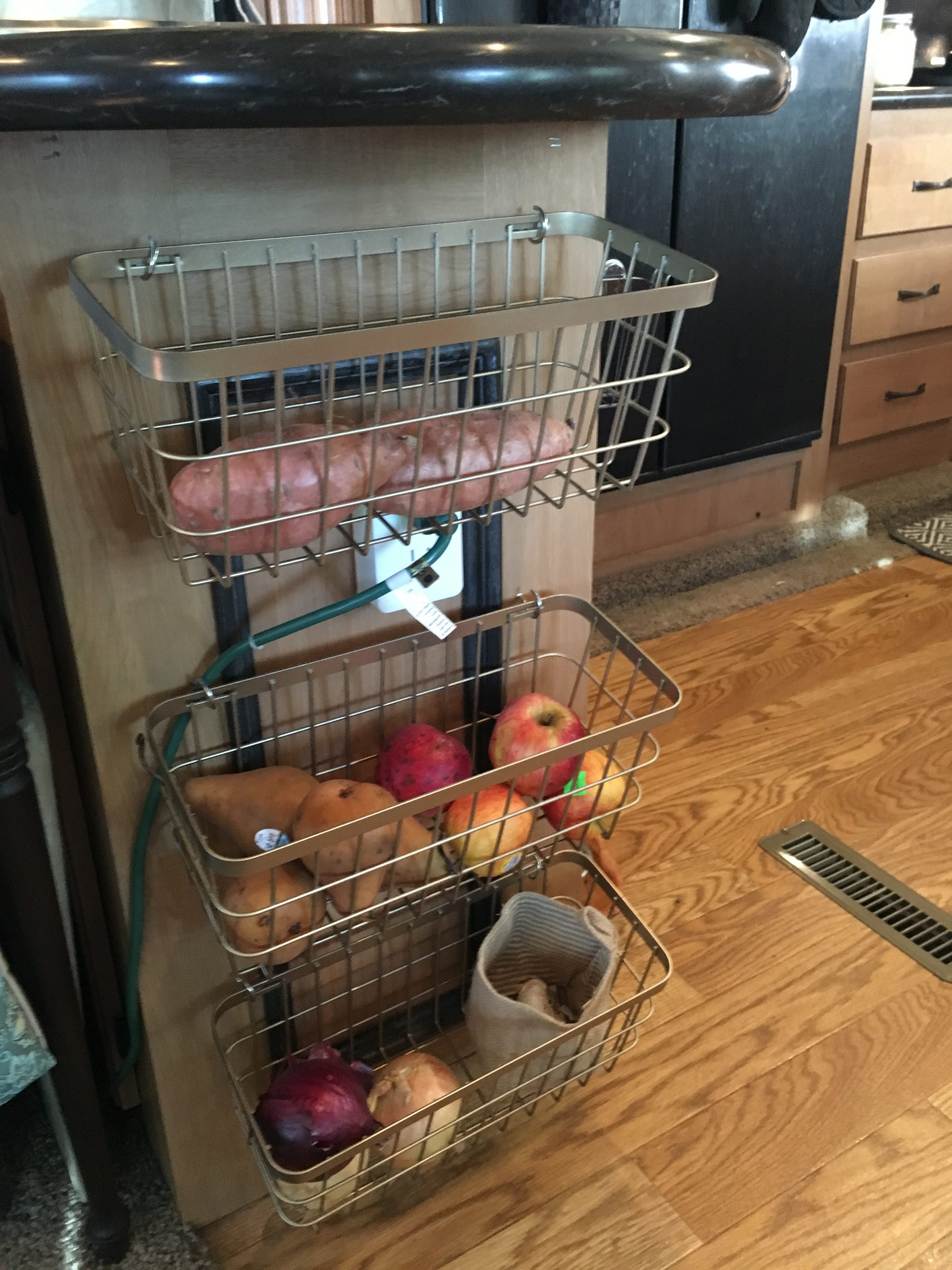 Over cabinet basket for fruit / root vegetable storage | RVinspiration.com | Ideas for campers, motorhomes, and travel trailers