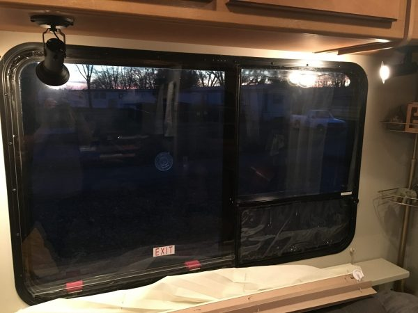 DIY RV storm windows made out of plexiglass and clear vinyl screen covers to insulate windows for cold weather in winter