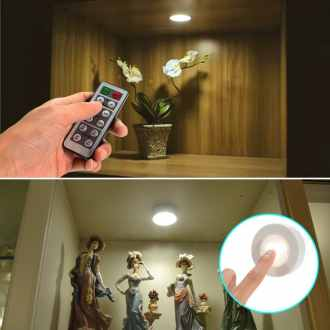 Adhesive touch light for adding lighting to dark closets, cabinets, shelves, etc.