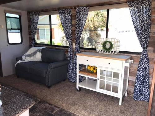 Fifth wheel slide with wood plank wallpaper accent wall by Cherice Perkins